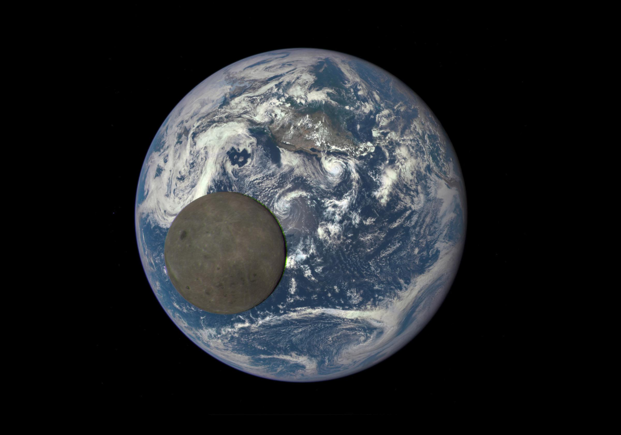Satellite image shows the far side of the moon crossing between a spacecraft and the Earth
