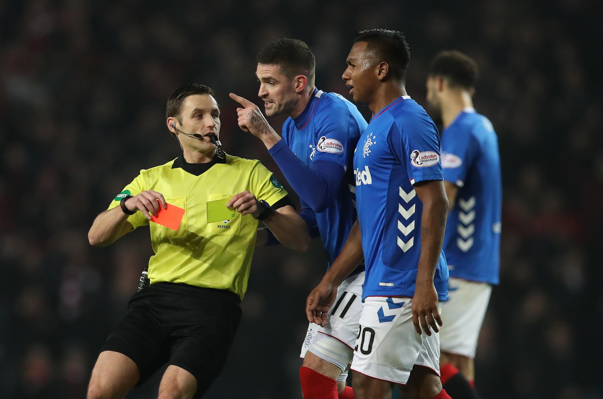 Referee Steven McLean shows Alfredo Morelos a red card, while team-mate Kyle Lafferty protests during their defeat to Aberdeen last Sunday