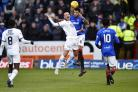 Kenny Miller of Dundee challenges for the ball with Rangers' Connor Goldson
