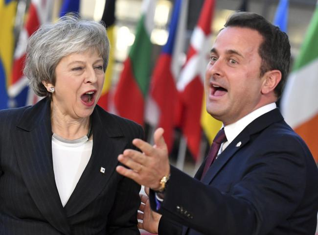 Theresa May looking in high spirits back in this picture with Luxembourg's PM Xavier Bettel