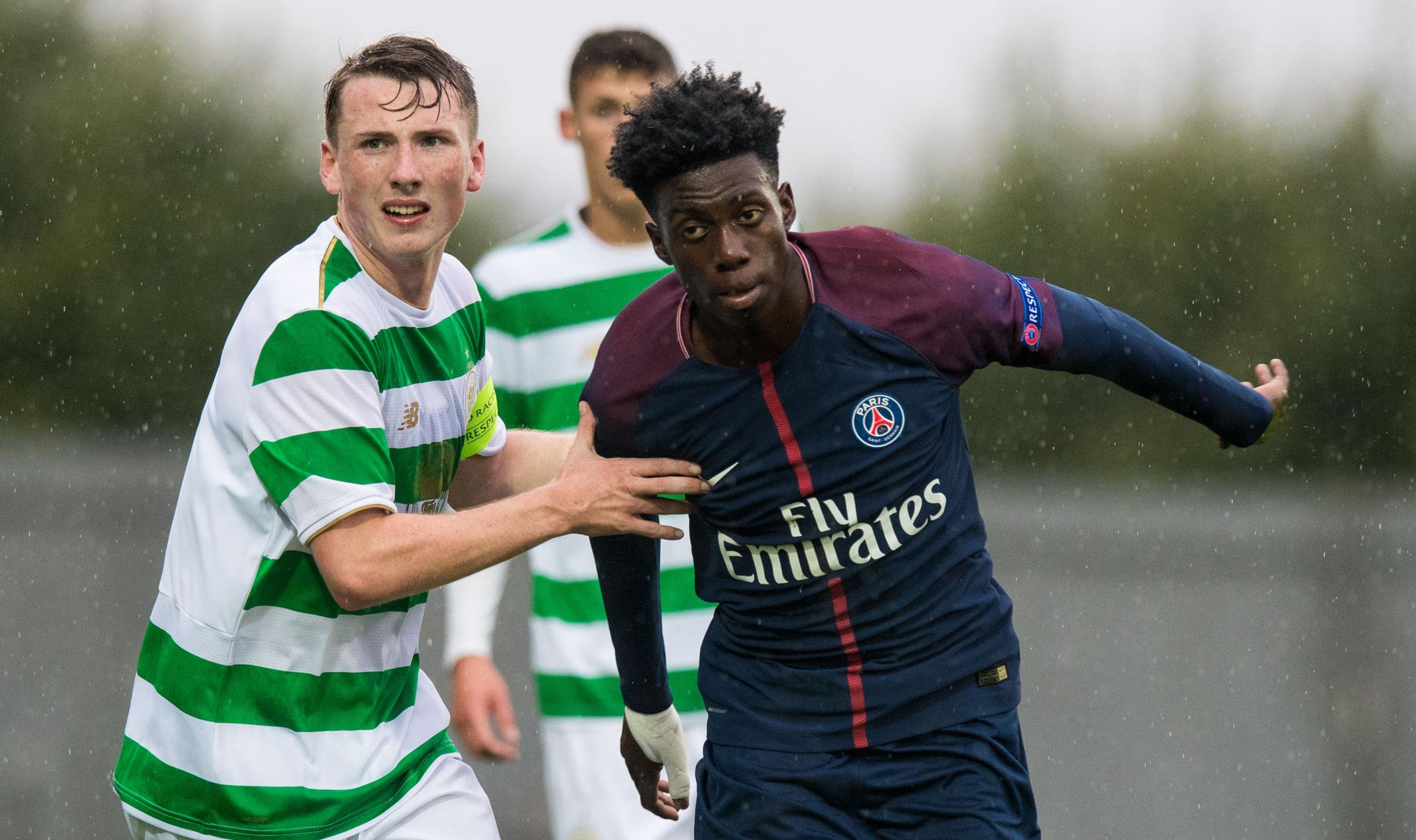 12/09/17 UEFA YOUTH LEAGUE.CELTIC U19 v PSG U19 (2-3).THE YOUR RADIO 103FM STADIUM - DUMBARTON.Regan Hendry of Celtic (left) in action against Timothy Weah of PSG.