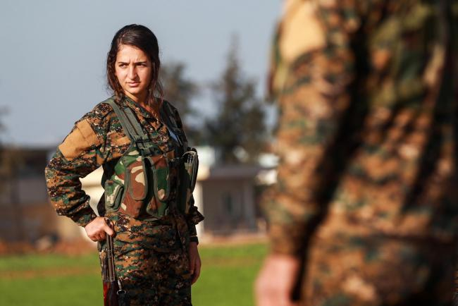 A fighter from the Kurdish women's protection units (YPJ)