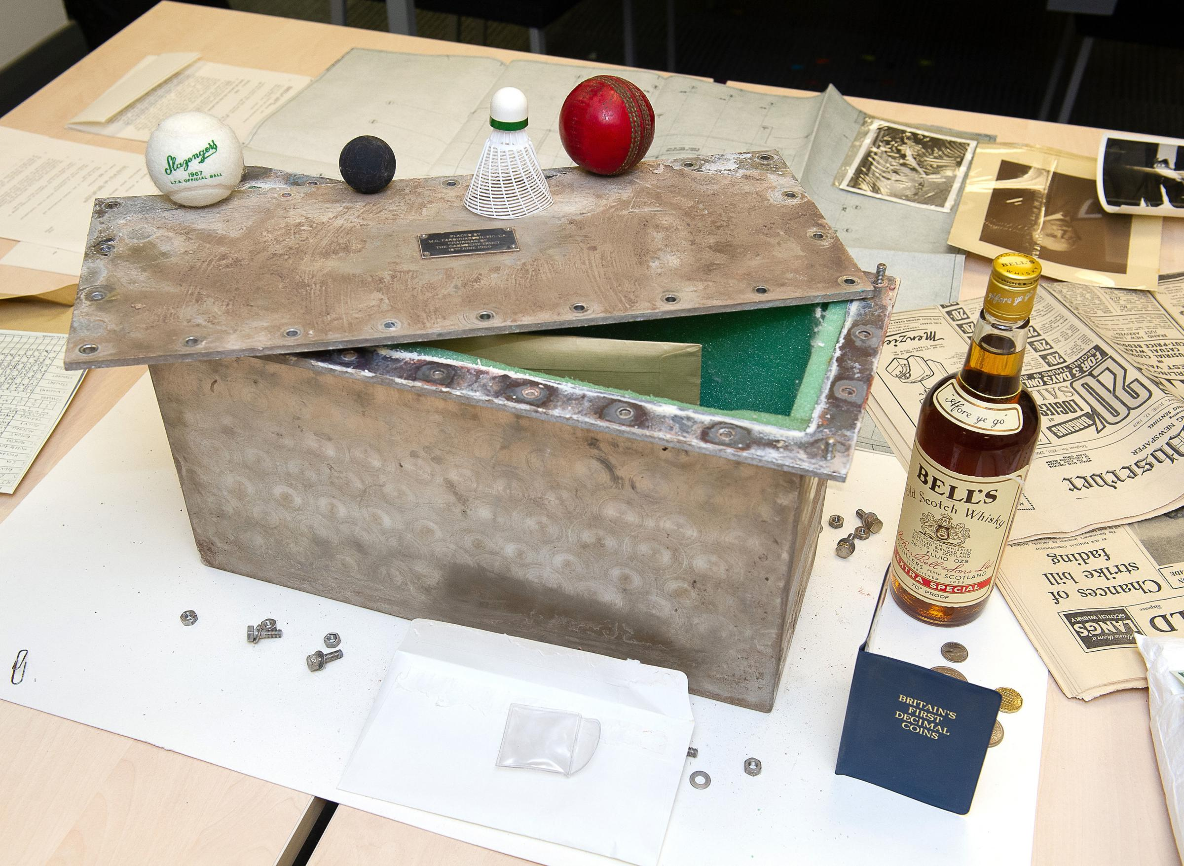 The time capsule include sporting items and a bottle of whisky