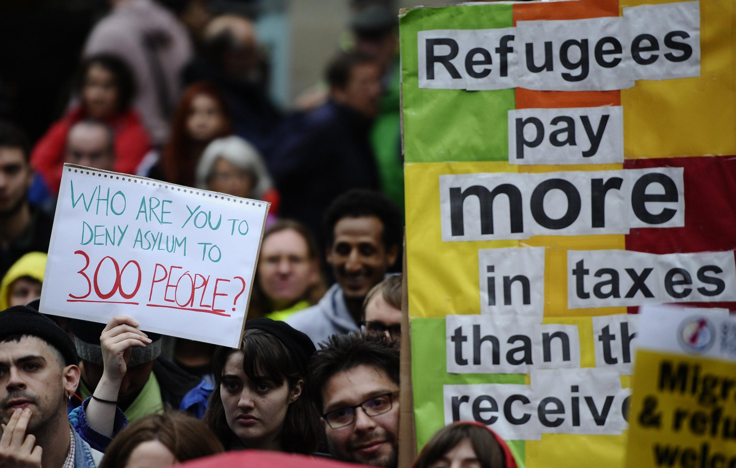 Demonstrators show their support for refugees at an event in Glasgow Photograph: Jamie Simpson