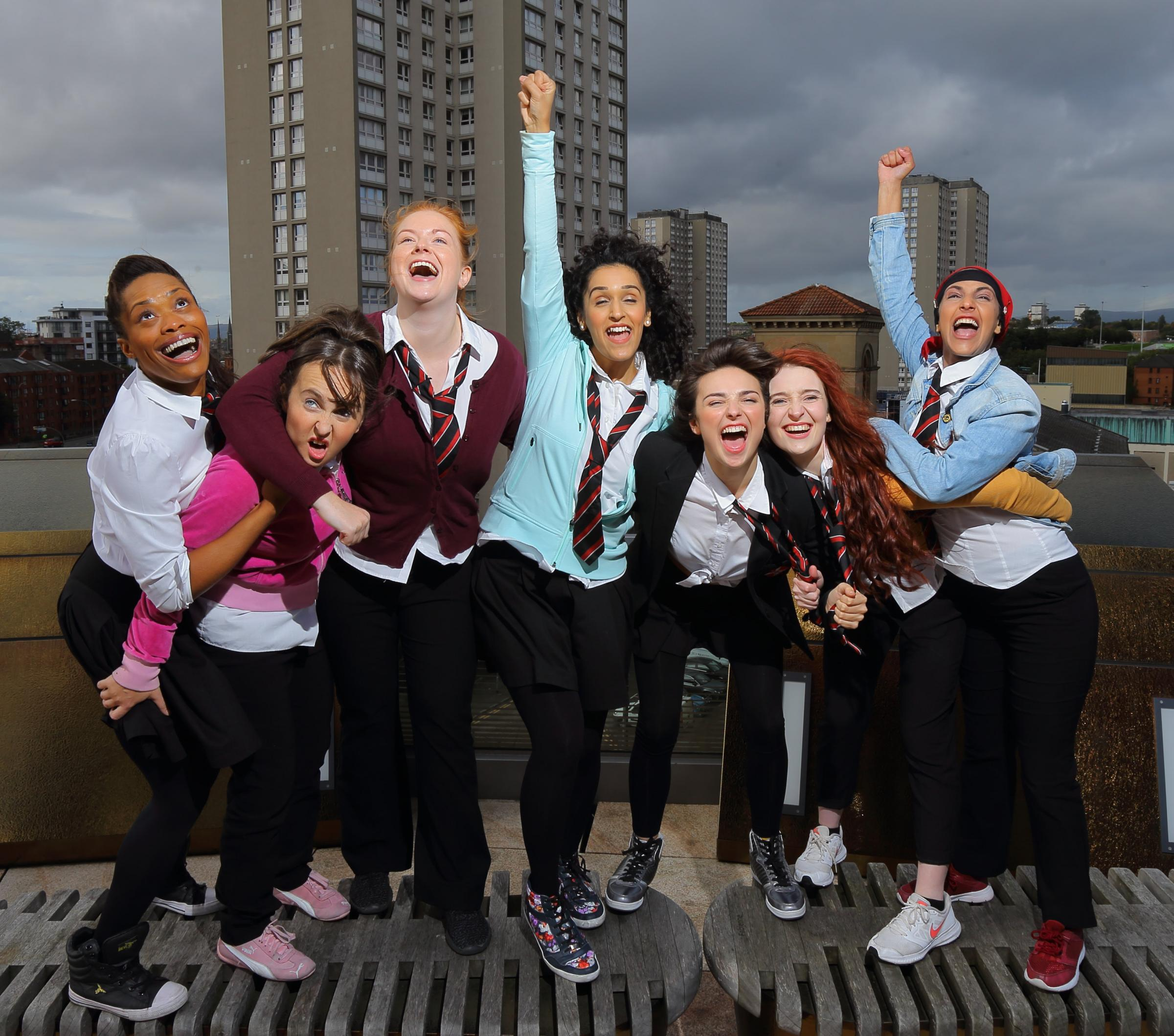 Glasgow Girls cast members, from left: Patricia Panther, Stephanie McGregor, Kara Swinney, Sophia Lewis, Chaira Sparks, Shannon Swan, Aryana Ramkhalawon. Photograph: Colin Mearns