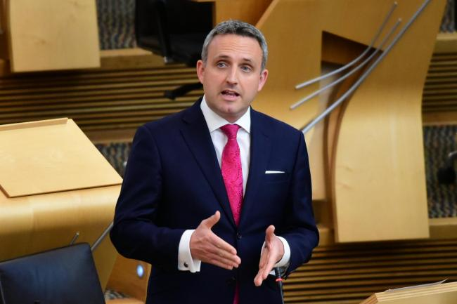 Liberal Democrat MSP Alex Cole-Hamilton sits on the group