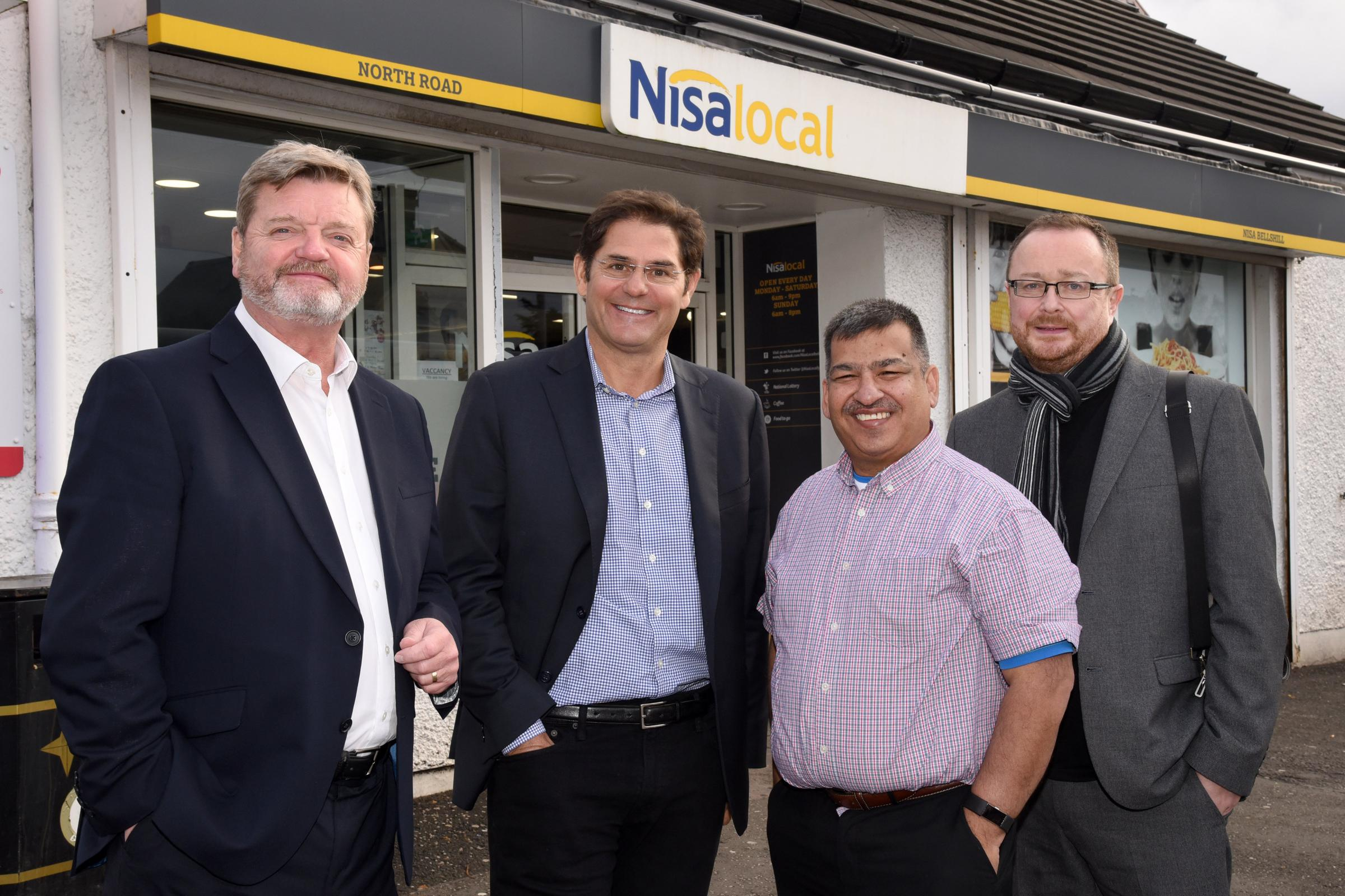 From left: Hugh Booth of Viridor, Bob Lincoln, Envipco president, Abdul Majid, Nisa Local owner and Dr John Lee, of the Scottish Grocers Federation