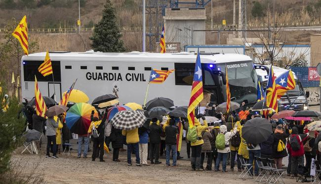 Nine of the 12 defendants are transferred to Madrid to stand trial, after more than a year locked in detention