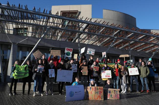 Schoolchildren have protested outside the Scottish Parliament over the climate change threat. Photograph: Stewart Attwood