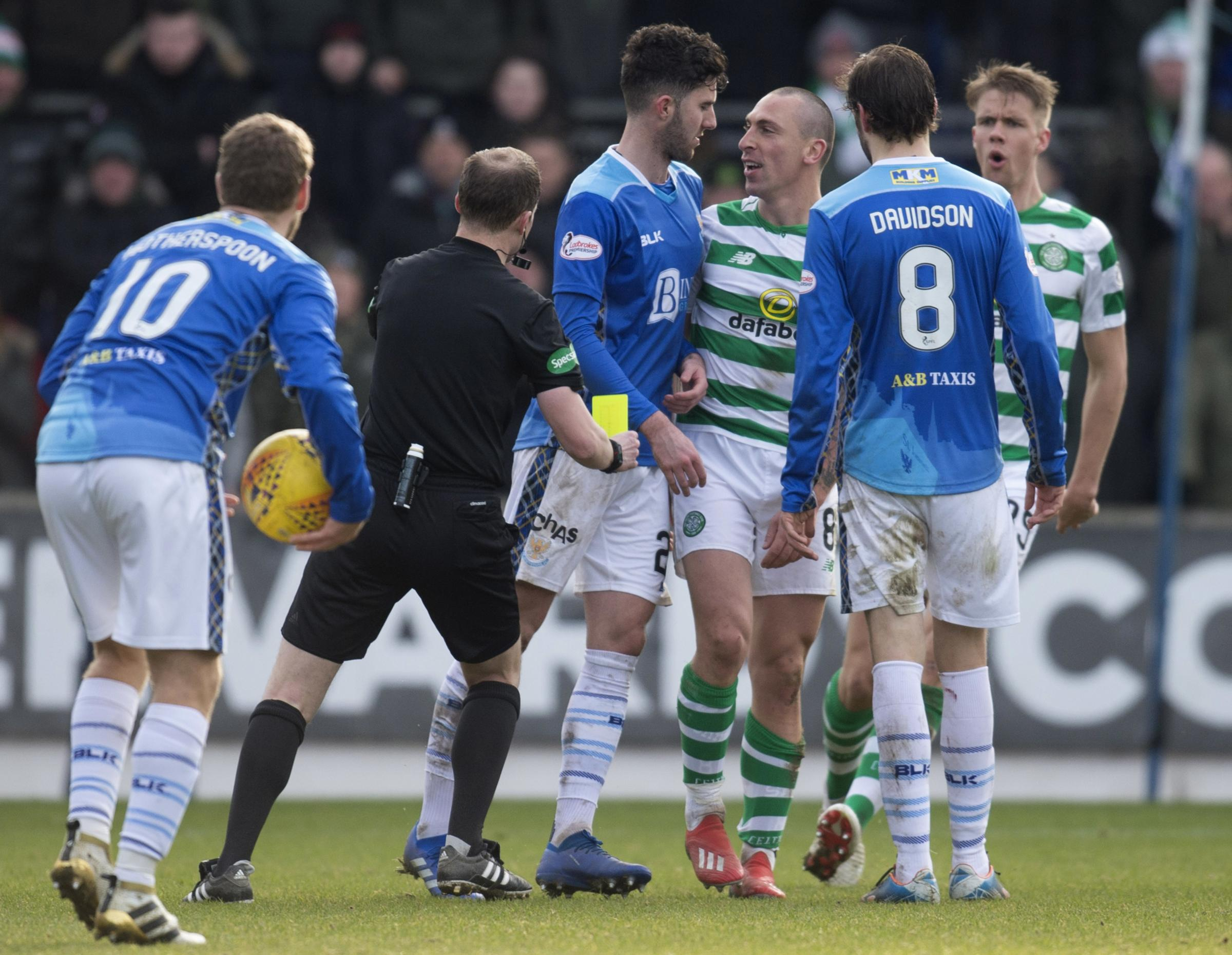 Sean Goss and Celtic captain Scott Brown square up to one another after a late tackle on the Celtic captain by the St Johnstone man.