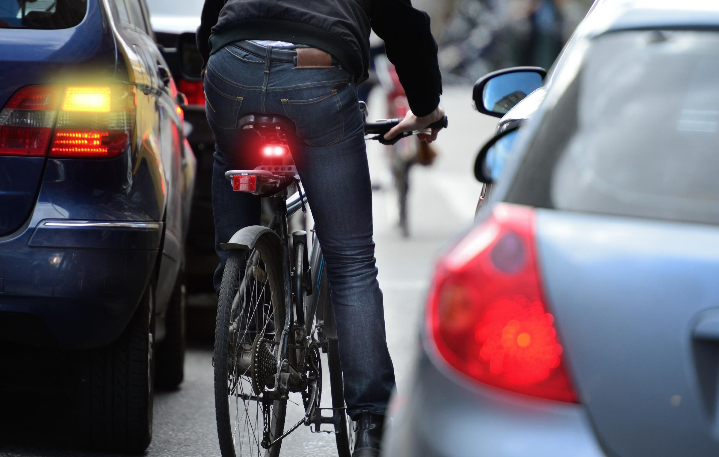 An MSP has implied it could be the fault of cyclists if drivers broke a new 20mph speed limit