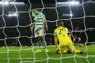 Emilio Izaguirre, left, and Scott Bain of Celtic look on after conceding their second goal to Valencia. Picture: Ian MacNicol/Getty Images.