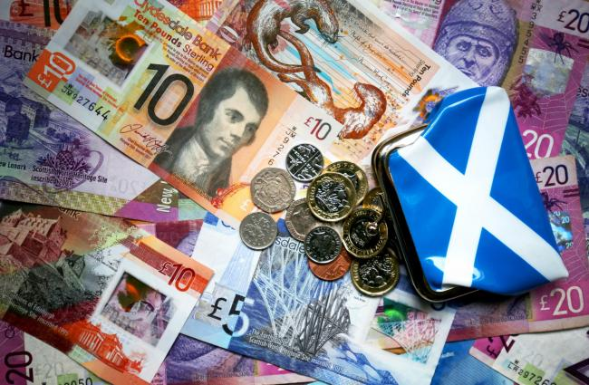 An independent Scotland would use the pound at first, the SNP has said