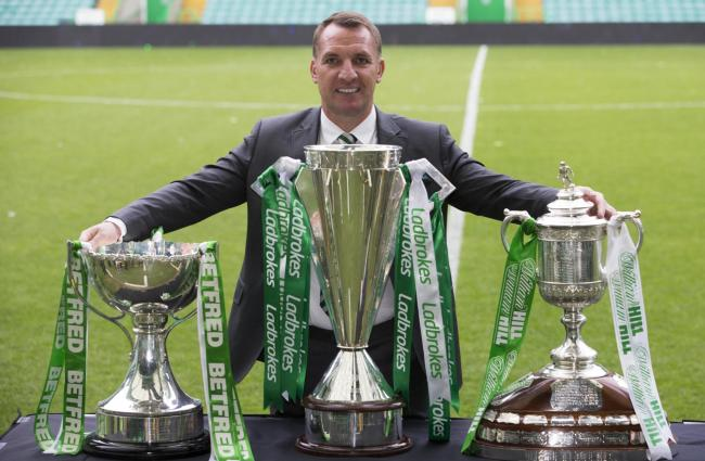 Brendan Rodgers poses at Parkhead with the three trophies Celtic won during  2017 18 season 72acd6cf38