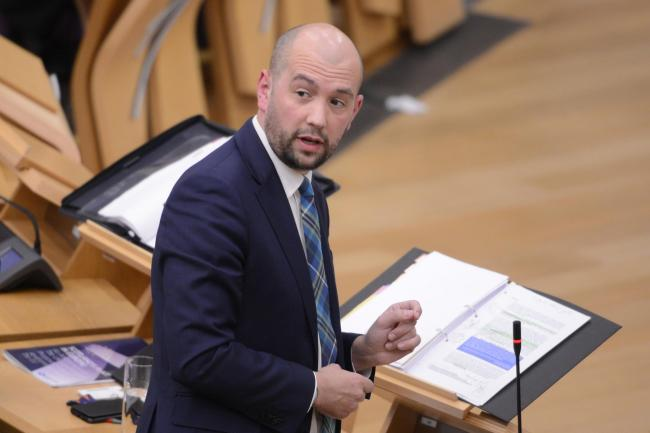 Ben Macpherson, Scottish Minister for Europe, Migration and International Development, during a session of Portfolio Questions dominated by Brexit in the Scottish Parliament. Photograph: Ken Jack
