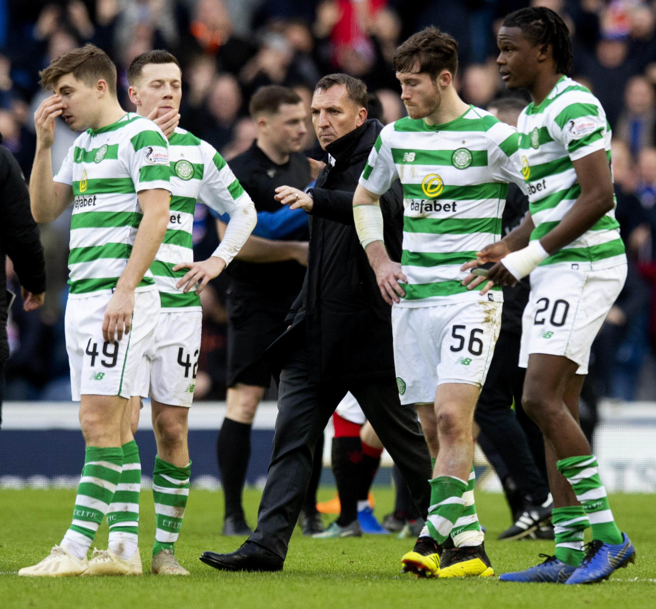 Celtic players, from left to right, James Forrest, Callum McGregor, Brendan Rodgers, Anthony Ralston and Dedryck Boyata after the 1-0 defeat to Rangers at Ibrox in December.