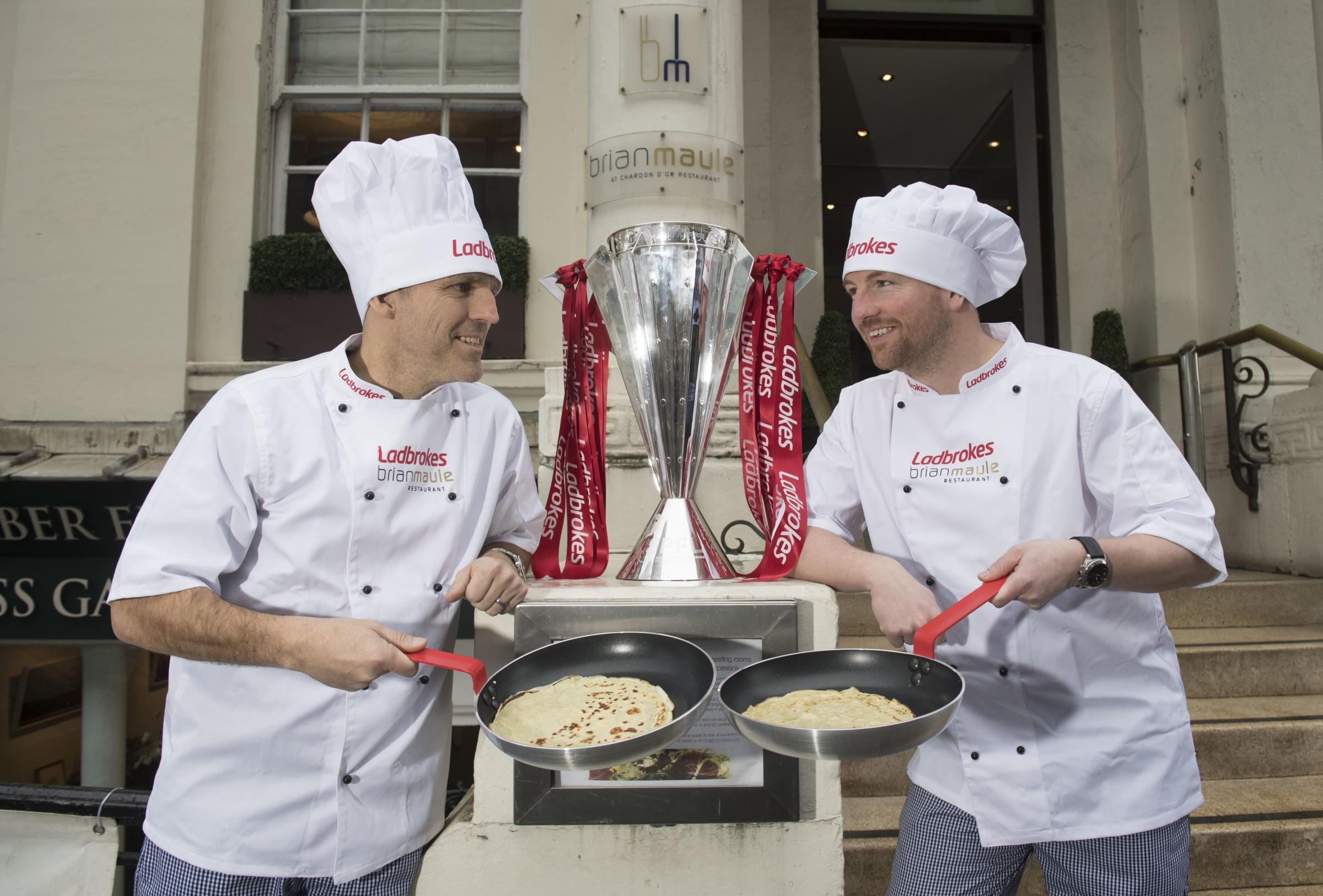 Former Rangers and Celtic stars Alex Rae, left, and Mark Wilson, right, go head-to-head in a Ladbrokes pancake tossing challenge.