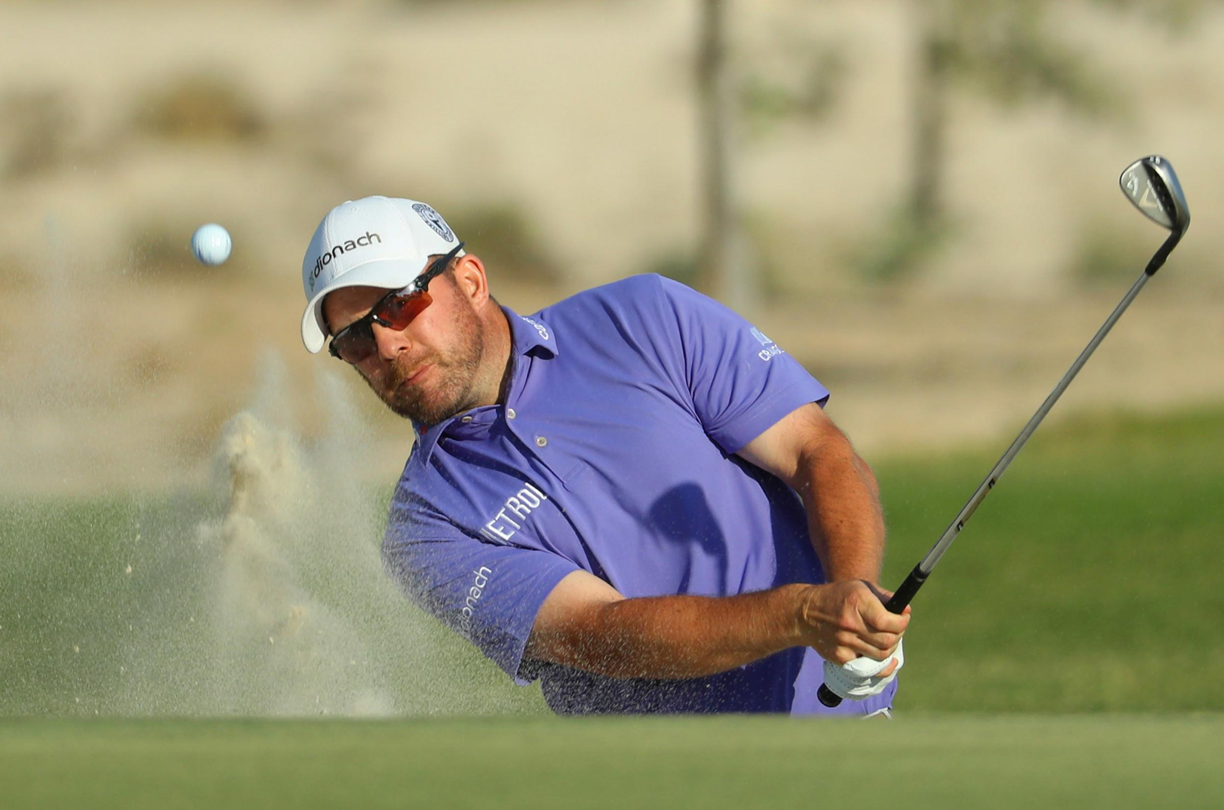Richie Ramsay plays from a bunker on the fourth hole during day one of the Commercial Bank Qatar Masters at Doha Golf Club