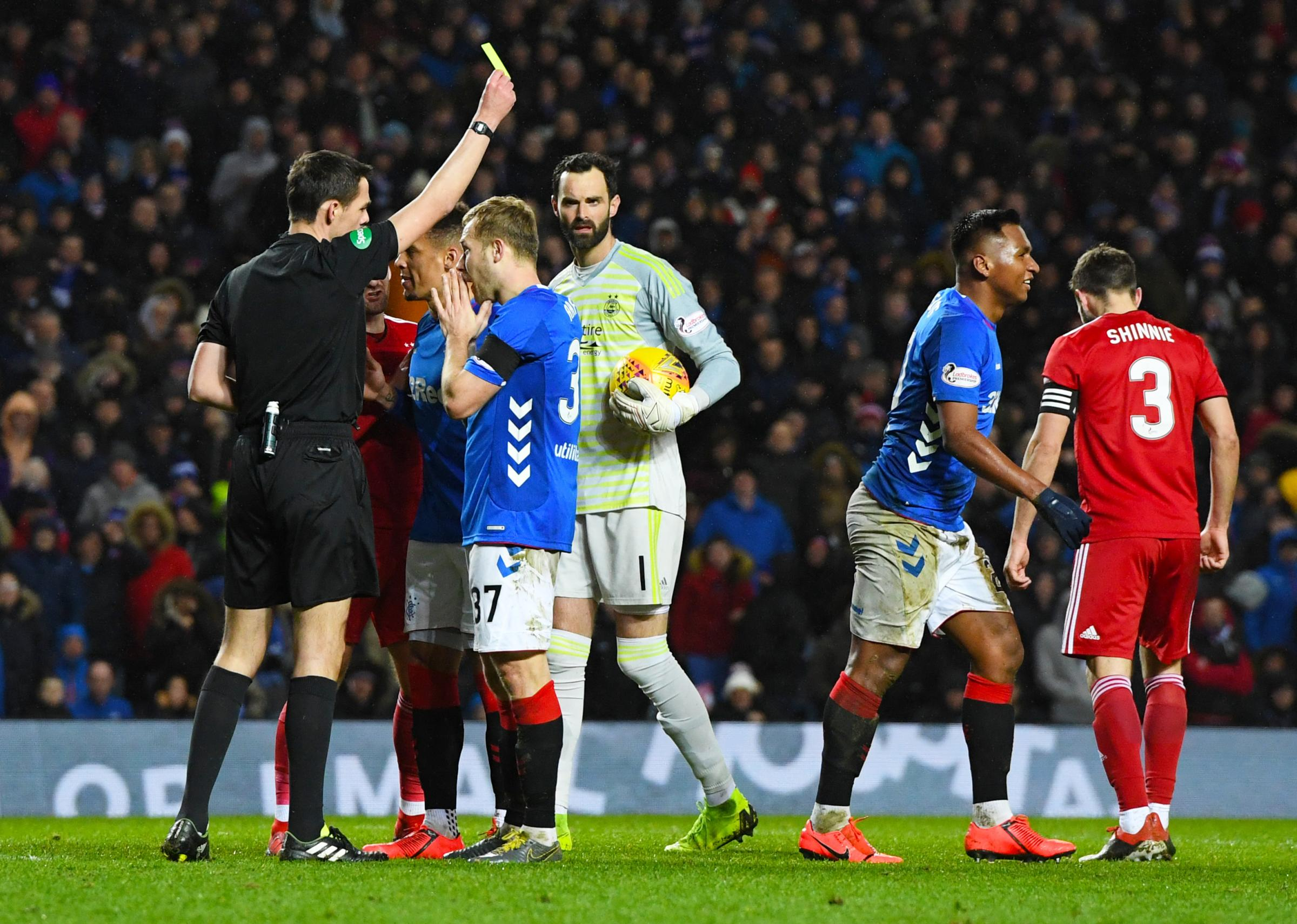 Rangers striker Alfredo Morelos, right, is booked by referee Kevin Clancy against Aberdeen.