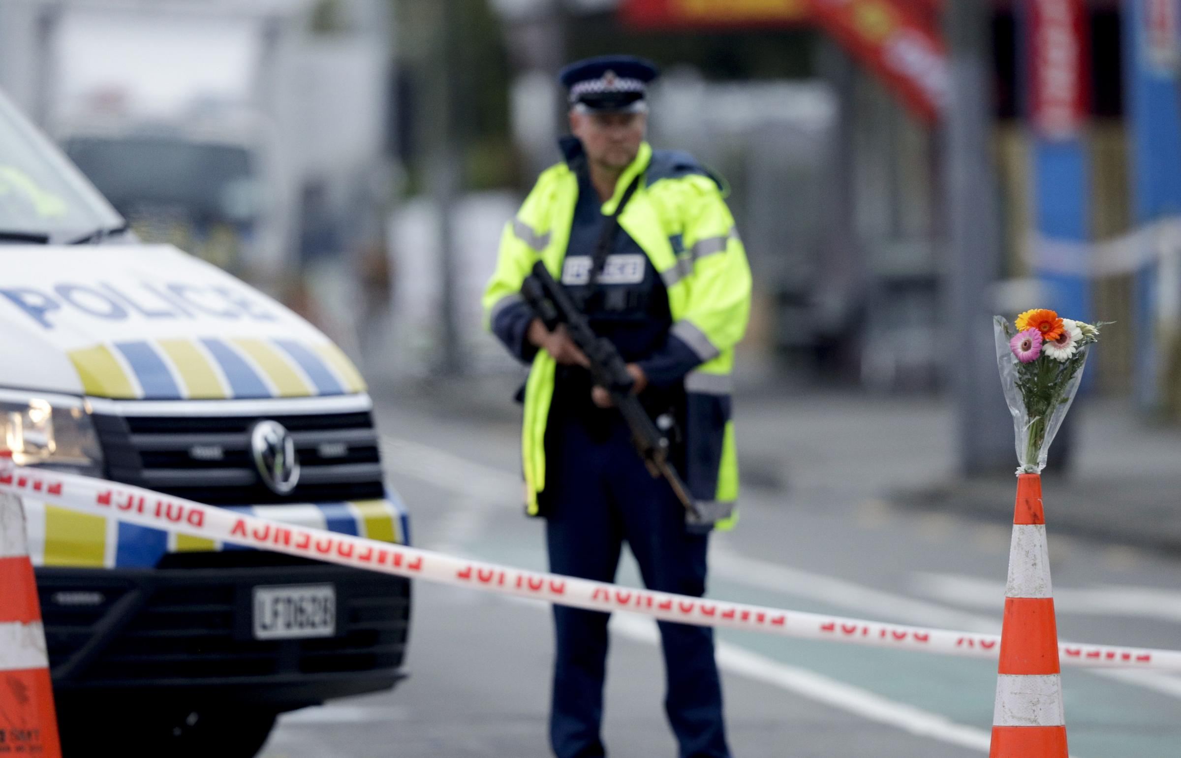 A Police officer stands guard near the Linwood mosque, site of one of the mass shootings at two mosques in Christchurch