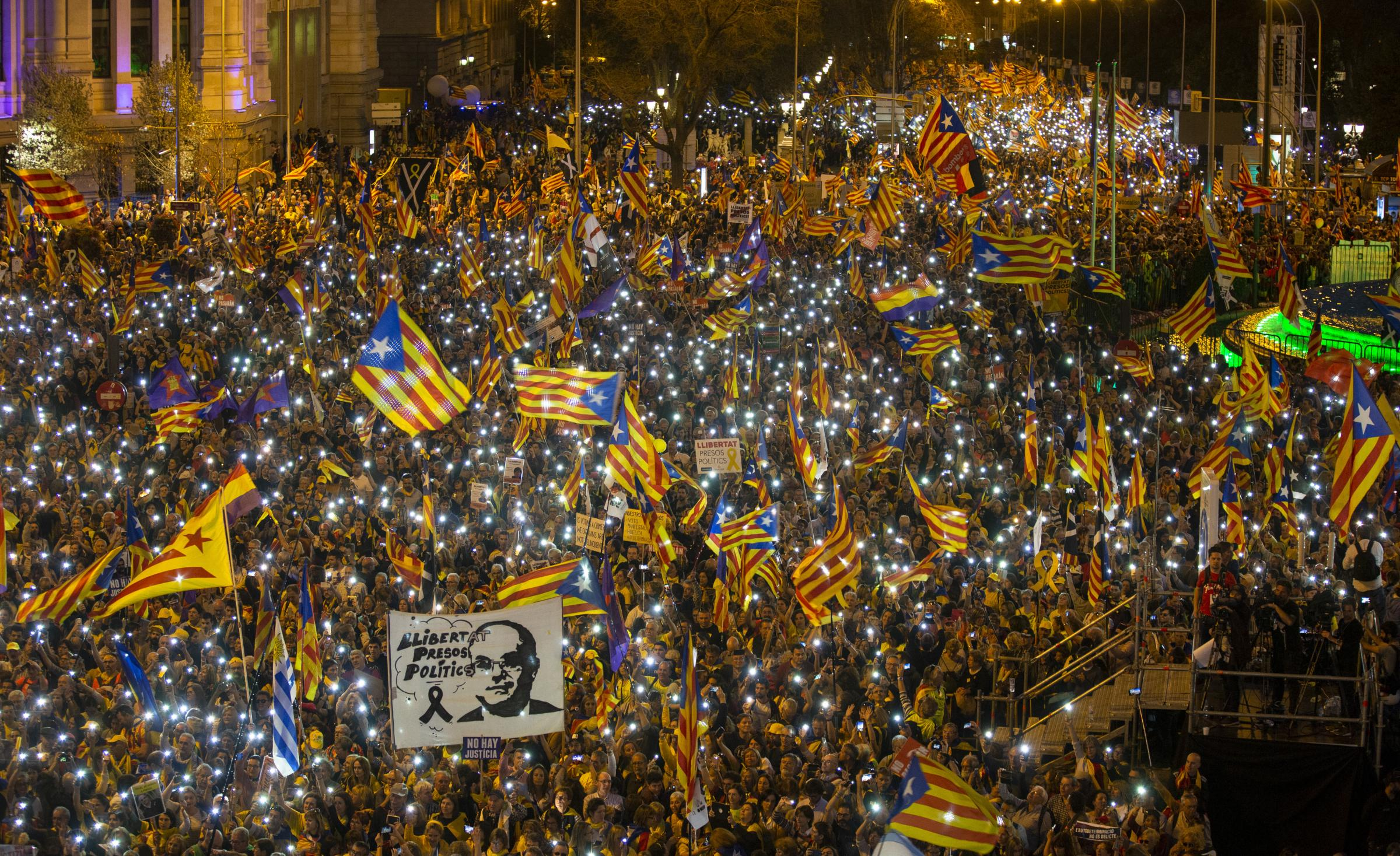 Demonstrators waved Catalan independence flags in Cibeles Square, Madrid, on Saturday night
