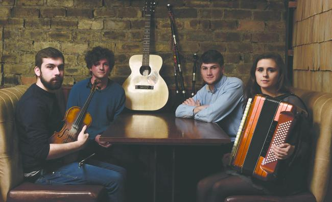 Nicky Kirk, centre left, formed Eabhal with fiddler Jamie MacDonald, accordionist Megan MacDonald and piper Hamish Hepburn