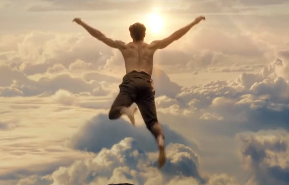 The advert features a man jumping off a mountain