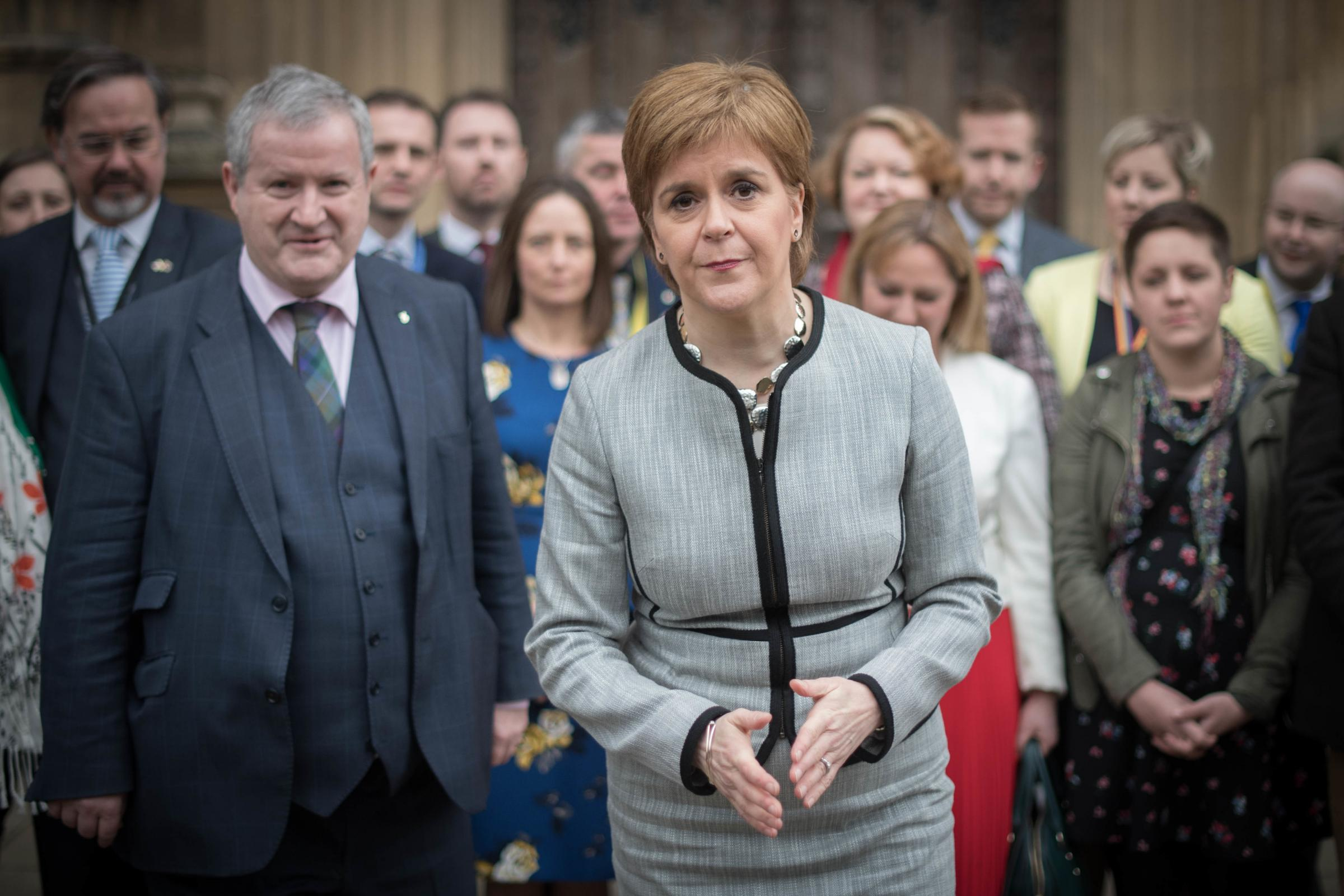 NIcola Sturgeon, pictured with the SNP MPs, said she will set out what Brexit means for Scotland in the longer term