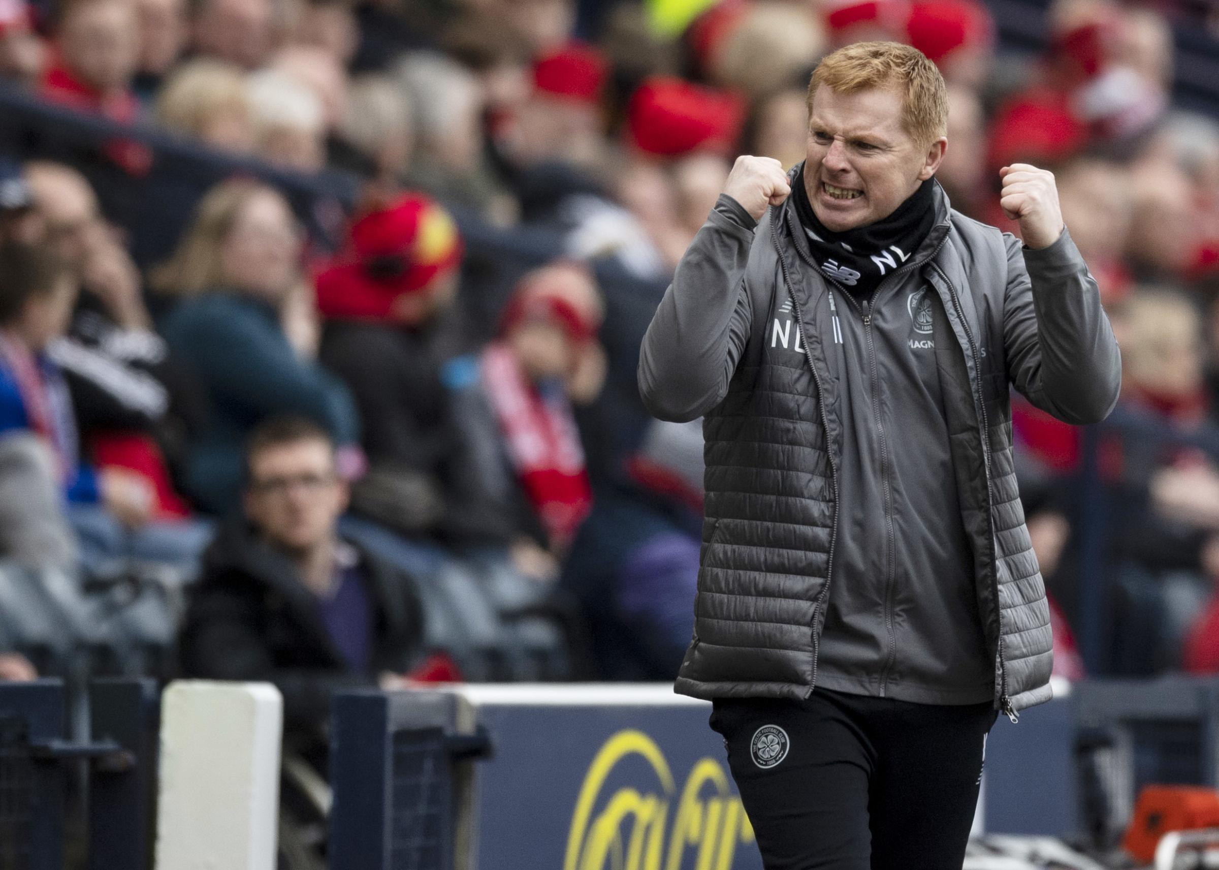 Celtic manager Neil Lennon celebrates his side's second goal against Aberdeen.