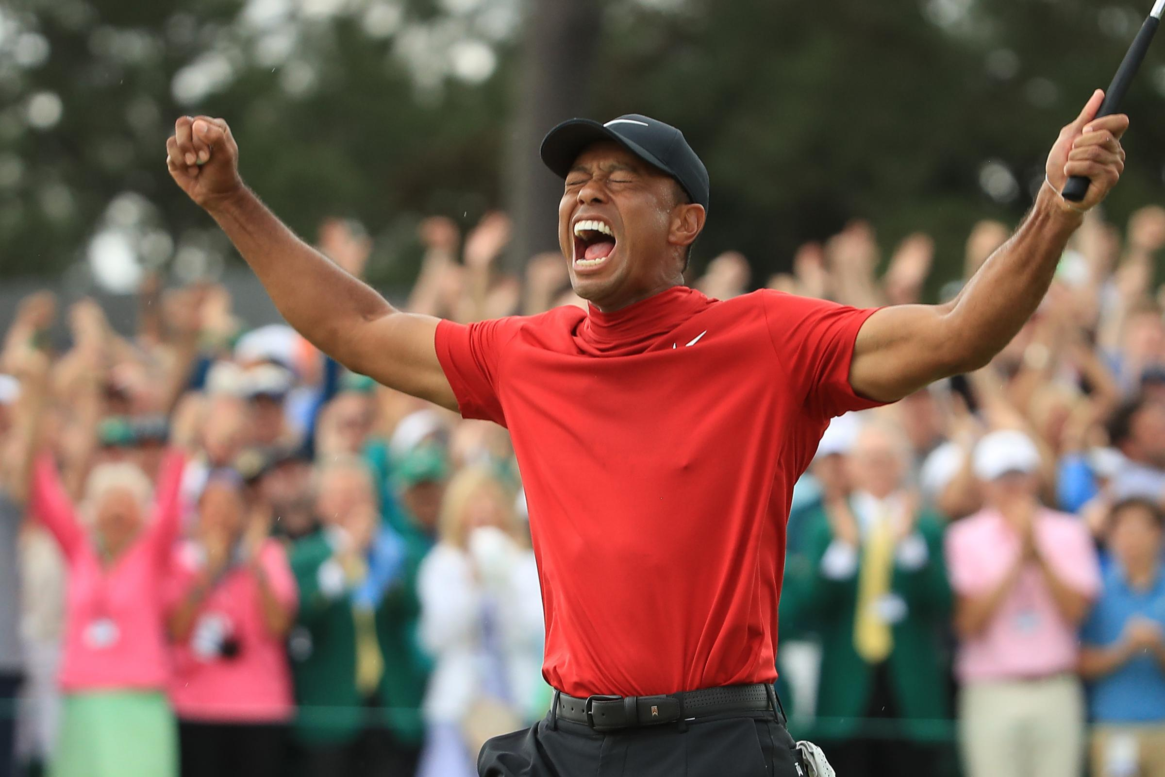 Tiger Woods celebrates after sinking his putt to win during the final round of the Masters