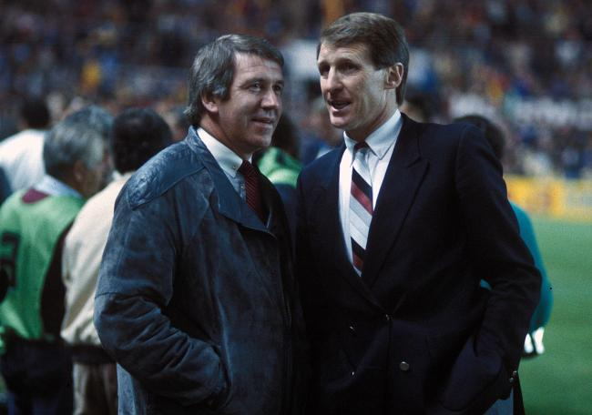 John Greig, left, talks to Celtic manager Billy McNeill, right, during his time in charge or Rangers.