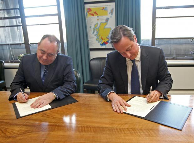The National: Alex Salmond and David Cameron signing the Edinburgh Agreement in 2012