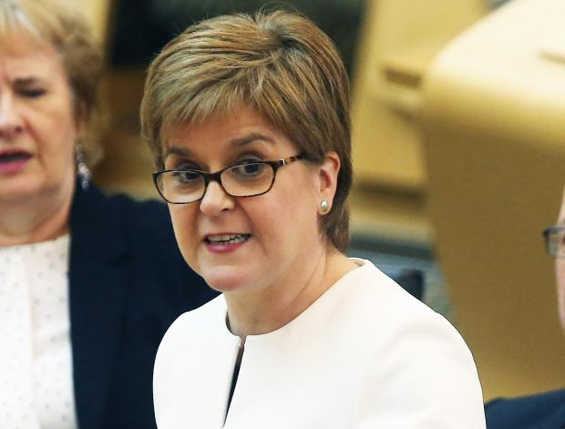 The National: Speaking at First Minister's Questions, Nicola Sturgeon said she could 'see the terror in Tory eyes' as support for independence surged. Photograph: Gordon Terris