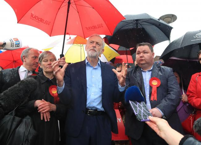 Labour leader Jeremy Corbyn with party supporters in Manchester