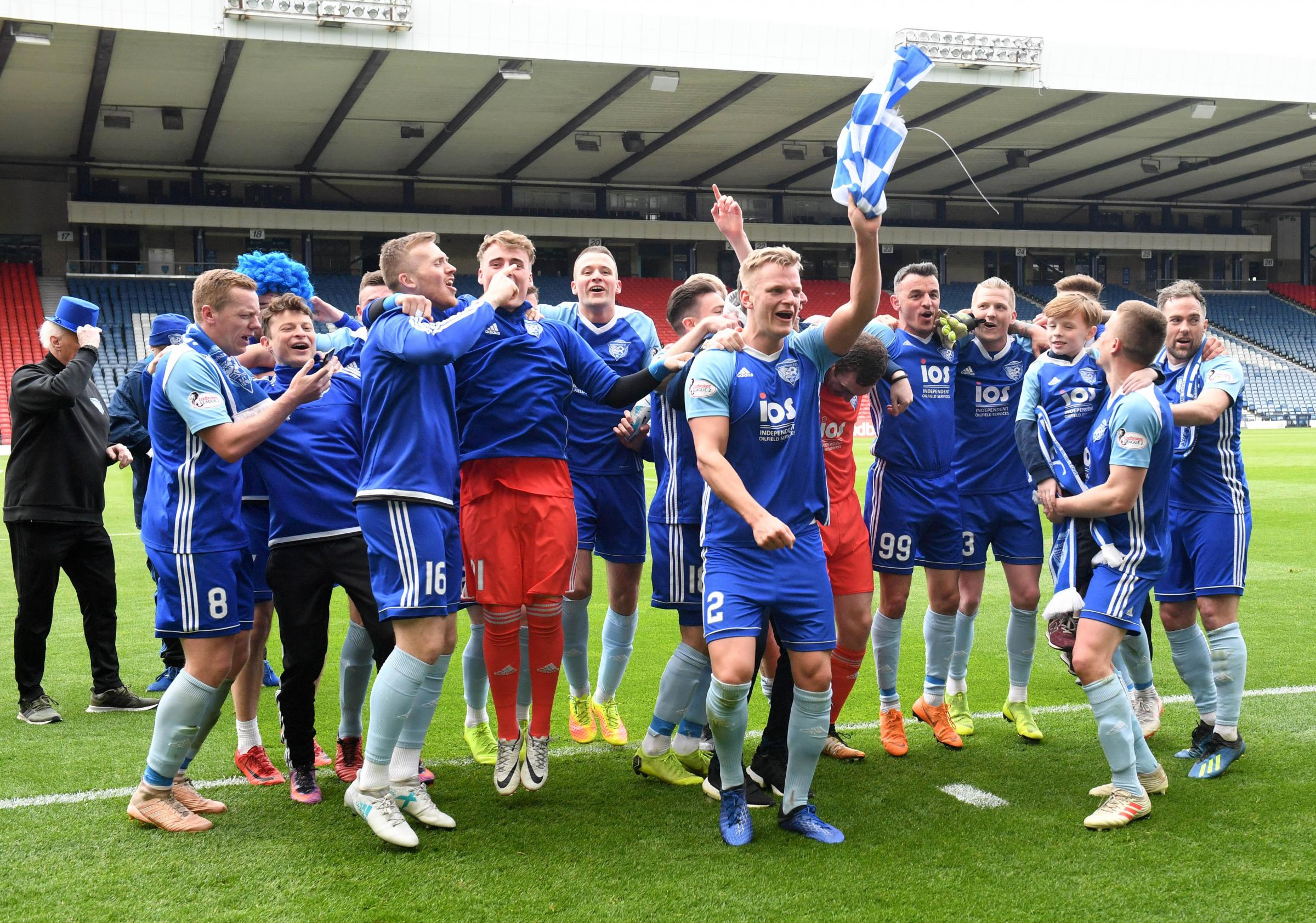 The Peterhead players celebrate their 2-0 victory over Queen's Park at Hampden