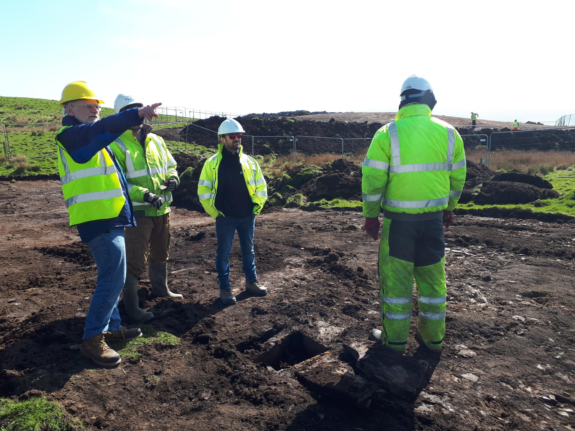 Pete Higgins, ORCA archaeology senior project manager, points out archaeological sites visible from the dig location on Orkney