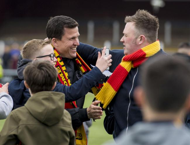 Gary Caldwell takes the acclaim of the Partick Thistle fans after keeping them up, but his decision not to offer Kris Doolan a new deal has sparked a backlash.
