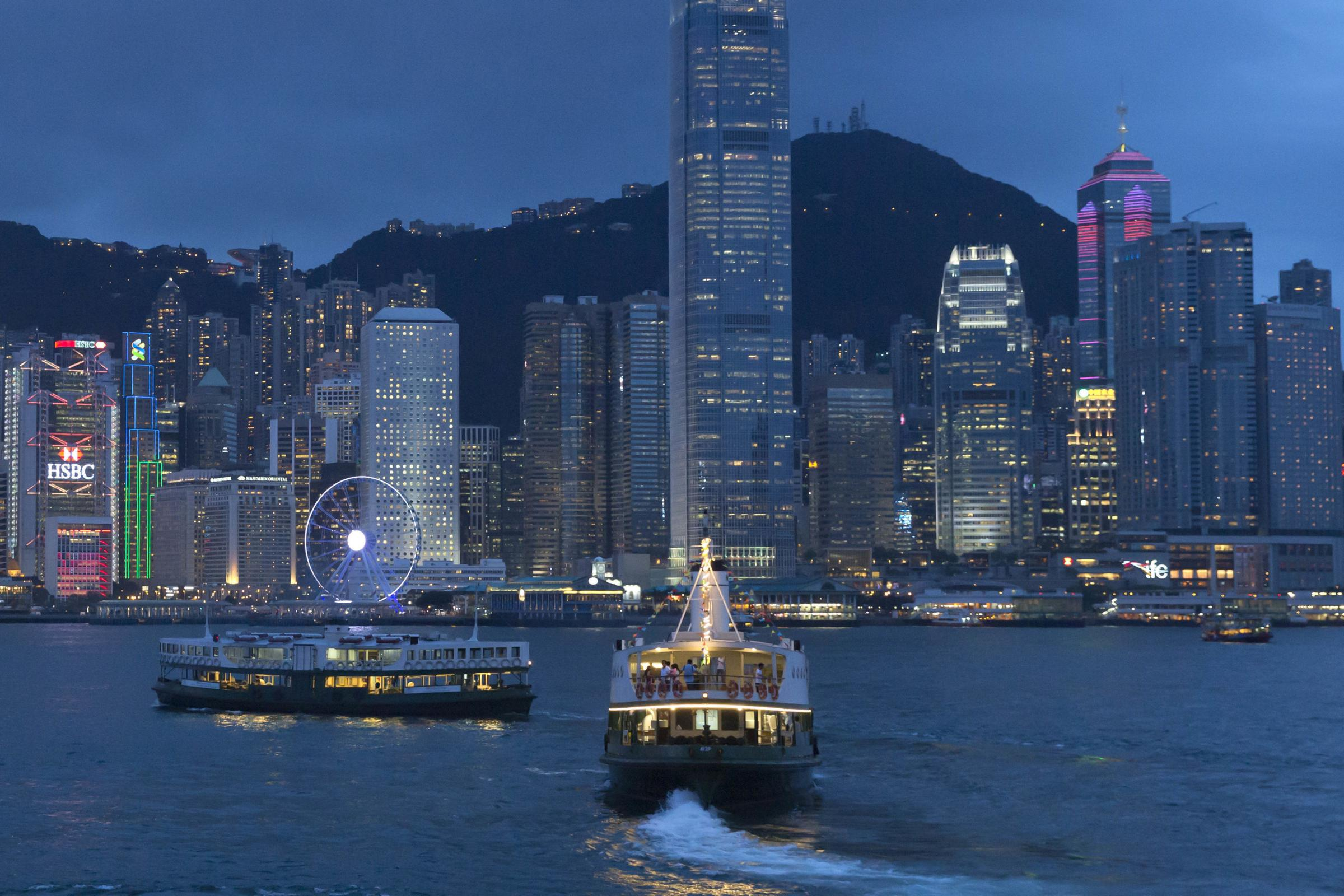 This June 20, 2017, photo, shows a general view of Victoria Peak and Central district over Victoria Harbor, in Hong Kong. Once known as Victoria after the British queen, Hong Kong island's waterfront formed the core of the British settlement after Hon