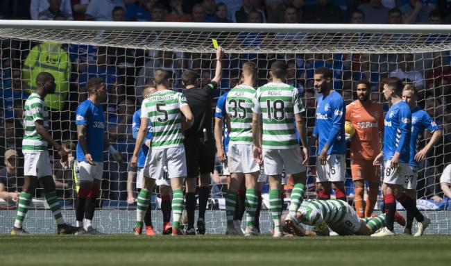 Referee Kevin Clancy shows Rangers defender Jon Flanagan a yellow card after an elbow on Celtic captain Scott Brown at Ibrox last Sunday.