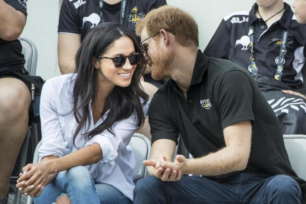 The National: Prince Harry and Meghan Markle share a look of love (Danny Lawson/PA)