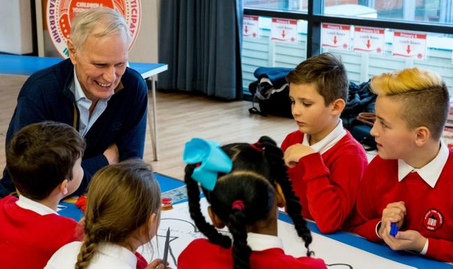 UN Special Rapporteur Philip Alston speaks to schoolchildren during a visit to Scotland last year that formed part of his research