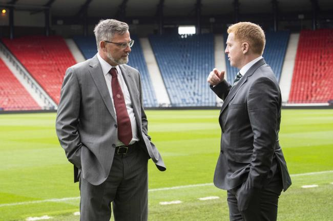 Hearts manager Craig Levein (L) speaks with Celtic manager Neil Lennon. Pic: SNS