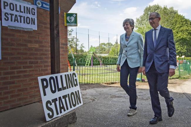 Theresa and Philip May cast their votes in the EU election –but her party is set for a dismal result