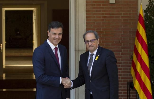 Catalan president Quim Torra, right, is seeking talks with Spanish PM Pedro Sanchez