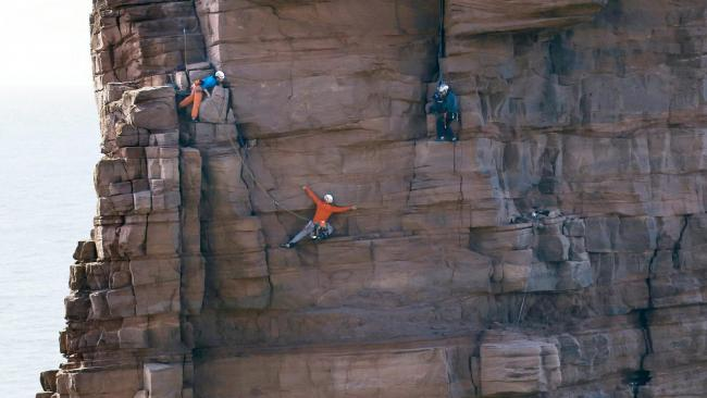 Jesse Dufton, a GB para climber who is blind, has become the first person to scale the 450-foot high Old Man of Hoy - with his sighted partner Molly Thompson.